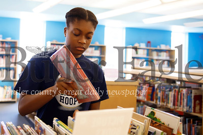 Library intern Sarayne Forbes, 16, of Butler organizes returned books before putting them back on the shelves at the Butler Public Library. Seb Foltz/Butler Eagle