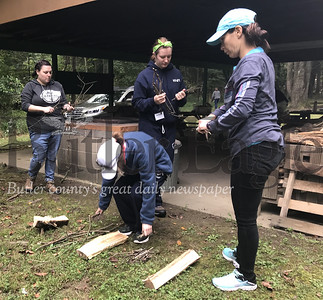participants gather tinder, kindling and fuel to build a fire and cook a meal at the Outdoor Training Summit hosted by the Girl Scouts Western Pennsylvania. Photo by Gabriella Canales.