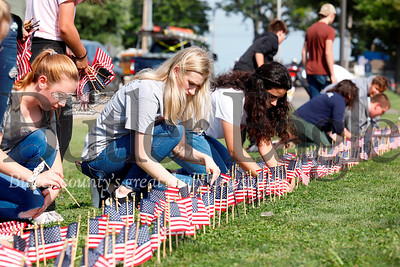 Students form Pine Richland and Mars ROTC place flags in front of Mars Senior High Shool Tuesday to honor September 11 victims. Seb Foltz/Butler Eagle