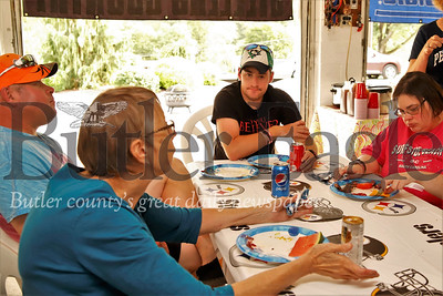 Cathie Petrosky (right), Mark Petrosky, Mark Robinson and Christine Braho sit down to dinner Saturday 083119 as part of a monthly friends group for adults with special needs. Braho founded the group with Nancy Robertson. Seb Foltz/Butler Eagle