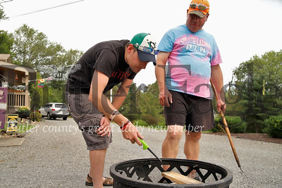 Mark Petrosky and Mark Robinson start up a fire following their friends group bbq. Seb Foltz/Butler Eagle.