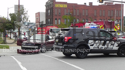 crash involving a car and dump truck at the corner of Wayne and Main streets around 10:15 a.m. Thursday morning left a woman passenger in the vehicle with neck pains, police at the scene said. A tow truck was called to remove the car.  Police did not say how the crash occurred or who was at fault. Photo by Nathan Duke/Butler Eagle