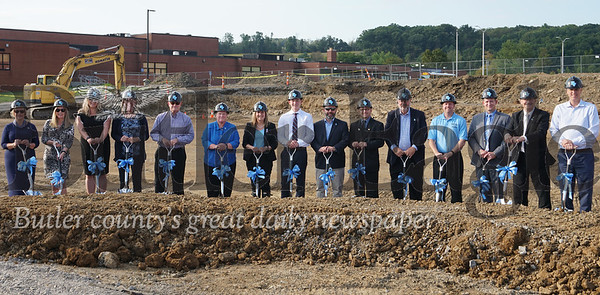 Photo by J.W. Johnson Jr.Pictured breaking ground on Seneca Valley's new aquatics center are, from left, Susan Harrison, school board member; Leslie Bredl, school board member; Amanda Fleming, health and physical education teacher; Kathy Whittle, school board member; Jeff Widdowson, school board member; Heather Lewis, athletic director; Tracy Vitale, superintendent; Matt Laslavic; James Nickel, school board president; Eric DiTullio, school board vice president; Frederick Peterson, school board member; Jim Pyle, health and physical education teacher; Brian Blackwell, swimming coach; Reid Moon, school board member; and Tim Hester, school board member.