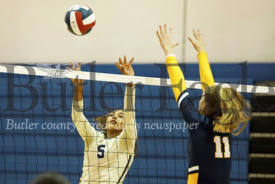 Butler freshman Ava Carney hits around a Katie Schlegal block attempt during Monday's 3-1 win at home against Mars Monday. Seb Foltz/Butler Eagle