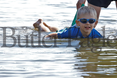 Murphy Smith of Butler enjoys a late summer swim in Lake Arthur Tuesday with a little assistance from his mom Emily. With school back in session, those who could make it out to Morraine State Park Tuesday enjoyed the park mostly to themselves. Seb Foltz/Butler Eagle