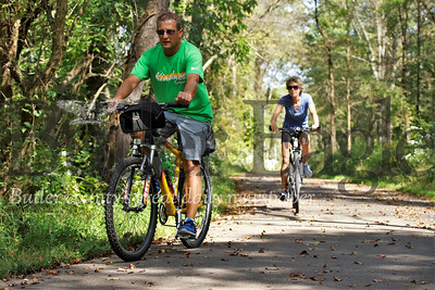 Paul and Cheryl Silvia take advantage of the sunshine to ride the Moraine Bike Trail Tuesday before checking into their lakeside rental cabin. Seb Foltz/Butler Eagle