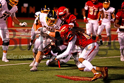 Mars running back Teddy Ruffner (36) push forward on a third quarter run deep in their own territory. The Planets started the drive pinned inside the 5-yard-line after a Penn Hills punt. Mars fell to Penn Hills 14-7 after allowing a big late game run for a touchdown. Seb Foltz/Butle Eagle