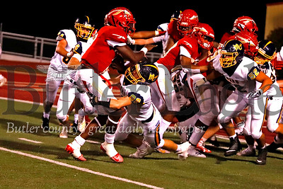 Mitchell Wright (88) and the Mars defense swarm Penn Hills quarterback Eddit McKissick for a big fourth and goal sack in the fourth quarter. Penn Hills scored the go-ahead touchdown on the ensuing drive, topping the Planets 14-7 at Penn Hills. Seb Foltz/Butler Eagle