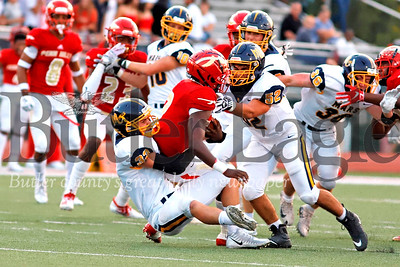 Mars linebacker Ben Chizmar (33) takes down Penn Hills quarterback Eddie McKissick for a first quarter sack with Gio Cuzzocrea (52) assisting. The Planets stout defense kept Penn Hills in check for much of the game. A few big plays and clutch mistakes cost the Mars a win. The Planets fell to Penn Hills 14-7 after a late fourth quarter break away run. Seb Foltz/Butler Eagle