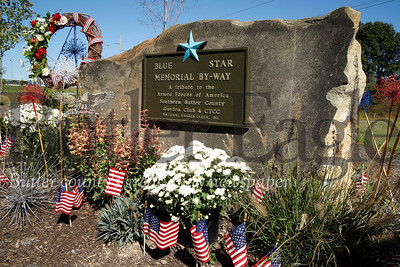 Officials from Cranberry Township and the Southern Butler County Garden Club dedicated the new Graham Park Blue Star memorial in the park's community garden Wednesday. Seb Foltz/Butler Eagle