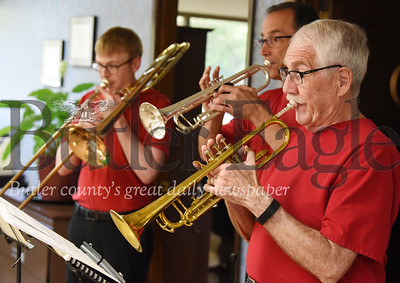 Harold Aughton/Butler Eagle: Members of the Trinity Brass band (left - right) Mark Dressler, trumbone; Kyle Golden, trumpet; and Jim Cunningham, trumpet; played at the 100th Anniversary celebration of Eagle Printing Wed., Sept. 18.