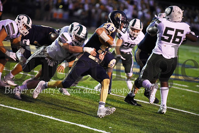 Harold Aughton/Butler Eagle: Butler's #43 attempts to turn it up field in last night's game against Pine-Richland.