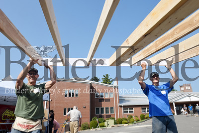 Harold Aughton/Butler Eagle: Roy Koegler (left) and Bruce Burtner joined other members of  St. Luke Lutheran Church, Sat. Sept. 24 to construct homes for veterans as part of the church's missionary project.