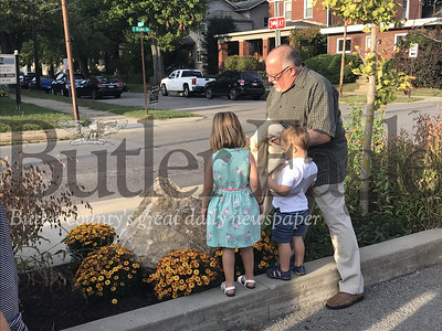Bob Dandoy of Butler and his grandchildren Eden and Van Matonak unveil the plaque dedicated to his late wife Julie Dandoy at the Butler Area Public Library on Wednesday. Photo by Gabriella Canales.