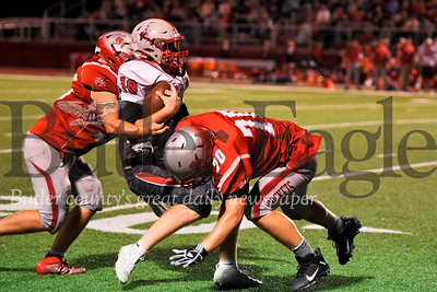 Gabriel Smithbauer(70) slows down Franklin quarterback Ian Haynes, setting up a Justin Schaeffer (55) sack for a clutch fourth down stop in the red zone in the second quarter. The stop held a 14-6 Rockets lead.  Seb Foltz/Butler Eagle