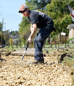 Harold Aughton/Butler Eagle: Nick Dorcy preps 60 feet of sidewalk prior to pouring concrete near Burin Post Office Wed., Sept. 25.