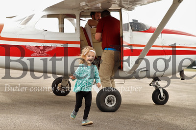 Charlote Cotter, 2, of Butler steps out of a single engine airplane  with her dad David during the Butler Airport's celebration of 90 years in opperation. Festivities included free plane rides, food trucks, a display of planes and other festivities. Charlotte and her brother Max both took their first flights in planes of that size. Seb Foltz/Butler Eagle