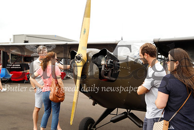 Guests to the Butler Airport's 90th birthday celebration check out a 40's era single engine airplane. The airport celebrated Saturday with food trucks, free single engine plane rides and other festivities. Seb Foltz/Butler Eagle