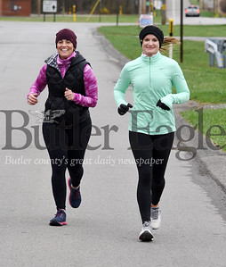 Harold Aughton/Butler Eagle: From left, friends Angela Shoop and Marie Pelloni, both from Saxonburg, went for a run during their lunch break while working from home due to the coronvirus Tuesday, March 31, 2020.