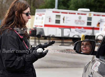Harold Aughton/Butler Eagle: Amy Behun, fire department administrative assistant, provides details of the volunteer opportunity to  Betty Foulkrod of Cranberry Twp. at the Public Safety Training Center Wednesday, April 1, 2020.