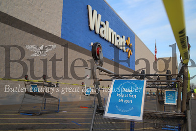 04/04/20 Butler Walmart: Area Walmarts recently began limiting shoppers and having shoppers line up outside with appropriate social distance spacing when the store is at capacity. Seb Foltz/Butler Eagle
