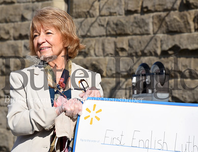 Harold Aughton/Butler Eagle: Mary Ann Swanson, coordinator for community dinners at First English Lutheran Church in Butler, accepts a check for $20,000 on behalf of the church from Walmart, Tuesday, April 14, 2020.