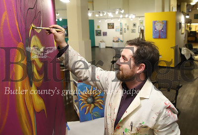 Butler Art Center art director Stephen Haley works on a mural in the center's gallery Thursday. While the closure due to the COVID-19 outbreak has been challenging to area nonprofits, it has given Haley and the Art Center the oppertunity to focus on renovatations. Seb Foltz/Butler Eagle 04/16/19