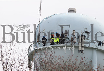 Contractors from STG Communications take a break from installing cell signal equipment on the water tower off of Route 8 north of Butler. An official onsite said it was the first cellular antenna installed on the tower. He could not confirm which carrier had contracted the installation. Seb Foltz/Butler Eagle