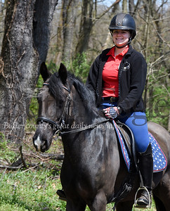 Harold Aughton/Butler Eagle:  Erin Vensel the Silver Crest Equestrian Center in Valencia rides her horse, King Julian, through the parking lot of Glade Run Monday afternoon, April 27, 2020.