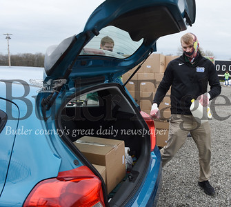Harold Aughton/Butler Eagle: Jordan Grady, Executive Director of the Butler County Chamber of Commerce, volunteered during the Greater Pittsburgh Area Community Food Bank food distribution event at the Big Butler Fairgrounds on Tuesday, April 28, 2020.