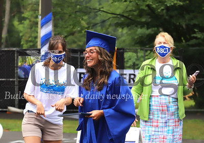 Sarah Landis walks off stage after recieving her diploma at Butler County Community College's drive-through graduation ceremony. Seb Foltz/Butler Eagle