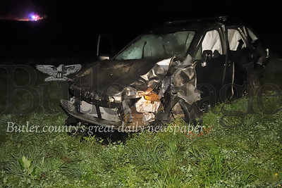 A vehicle traveling north on Route 19 in Muddy Creek Township around 9:30 p.m. Tuesday, August 4, 2020, hit a guard rail and landed in a field, ejecting the male driver, state police said.  His female passenger was also injured.  A medical helicopter was called to land in the field, but the flight was aborted due to fog in the area, police said. The driver and passenger were taken by ambulance to a hospital. Photo: Seb Foltz/Butler Eagle