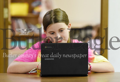Harold Aughton/Butler Eagle: Isabella Young, 10, works on a project at Kiddie City Wednesday morning, August 5, 2020.