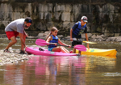 Mark Varlotta assists his daughter Sienna, 10, and son Gianni,11, at the Porters Cove boat launch on Connoquenessing Creek Wednesday. Seb Foltz/Butler Eagle 08/05/20
