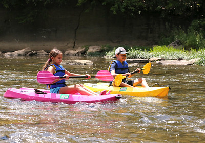 Sienna Varlotta, 10, and her brother Gianni Varlotta,11, paddle their kayaks during a family float at  Porters Cove on Connoquenessing Creek Wednesday. Seb Foltz/Butler Eagle 08/05/20