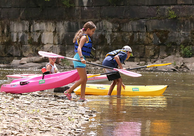 Sienna Varlotta, 10, and her brother Gianni Varlotta,11, get ready to launch their kayaks for a family float at the Porters Cove boat launch on Connoquenessing Creek Wednesday. Seb Foltz/Butler Eagle 08/05/20