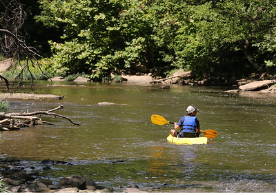 Gianni Varlotta, 11, floats Connoquenessing Creek Wednesday with his family. Seb Foltz/Butler Eagle  08/06/20
