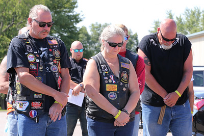 Walt (left) and Beth Skibicki and other American Legion Riders bow there heads in prayer prior to Saturday's annual benefit ride. Seb Foltz/Butler Eagle