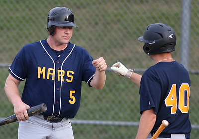Mars #5 celebrates with #40 after scorring a run. #5 scored on the play. Seb Foltz/Butler Eagle
