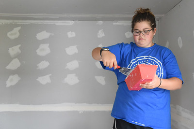 Harold Aughton/Butler Eagle: Morgan Waldroup, 21, prepares to plaster drywall as part of the Chicora Alliance Church renovation project on E. Slippery Rock Street Wednesday, August 12, 2020.