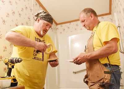 Harold Aughton/Butler Eagle: Volunteer Pete Walowen and pastor Mark Wallace of the Chicora Alliance Church work on renovating a bathroom Wednesday, August 12, 2020.