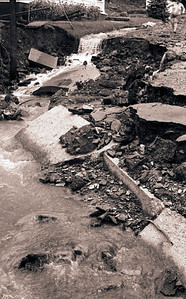 STREET COLLAPSES – In East Brady, flood waters ripped away sections of Brady Street, revealing storm sewers. August 14, 1980. – Butler Eagle Photo