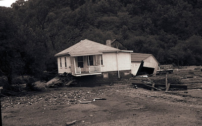 FLOOD DAMAGE – The fron porch and garage of this Bradys Bend home werer destroyed in Thursday's (August 14, 1980) Flood. Butler Eagle Photo.