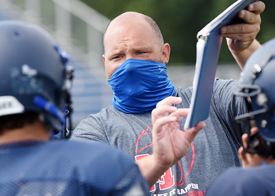 Harold Aughton/Butler Eagle: Receivers coach Erik Germani goes over the play with the offensive Tuesday morning August 18, 2020.