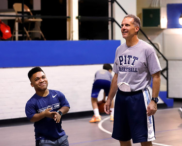 Coach Ron McNabb watches practice with former Knoch  basketball team manager and Penn State freshman Malachi Schworm. Seb Foltz/Butler Eagle