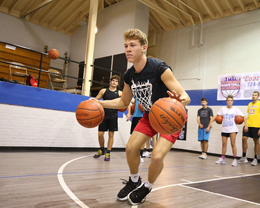 Knoch junior Ryan Lang shuffles sideways during a two-basketball dribble drill at Ron McNabb's basketball camp. Seb Foltz/Butler Eagle