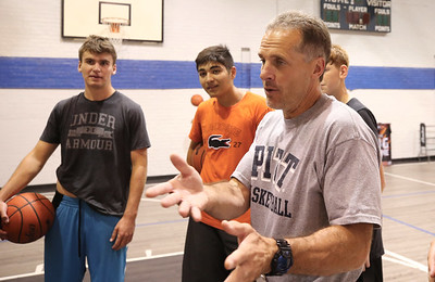 Ron McNabb chats with some of his basketball camp players following a training session. 08/19/20