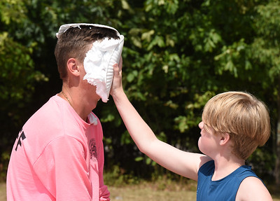 Harold Aughton/Butler Eagle: Jayden Wiltse, 10, puts a pie in the face of counselor Josh Albert, a senior at Slippery Rock University, at Camp Alameda Friday, August 21, 2020.