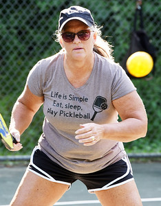Harold Aughton/Butler Eagle: Brenda Powel of Butler eyes up a return during a pickle ball game at Ritts Park in Butler, Wednesday, August 12, 2020.
