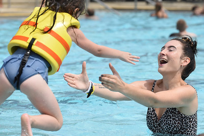 Harold Aughton/Butler Eagle: Madalyn Guthrie, a leadership couselor for Grace Youth and Famly Foundation, catches Alicia Harp, 6, of Butler after jumping into the Alameda Pool, Friday August 21, 2020.
